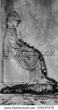 Bas-relief depicting a mourning young woman on headstone at  Montparnasse Cemetery in Paris (France) Aged photo. Black and white. - stock photo