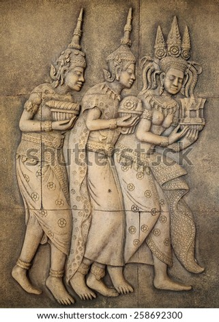bas-relief of Khmer civilization in a sandstone wall - stock photo