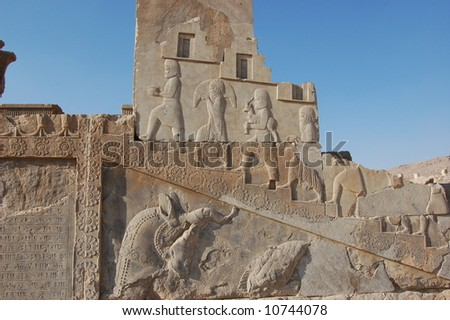 Bas-relief of people climbing stairs with offerings.  Persepolis.  Iran.