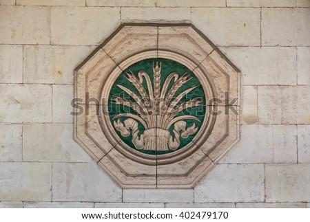 Bas-relief of the Soviet era in the building of the pavilion. Kiev, Ukraine - stock photo