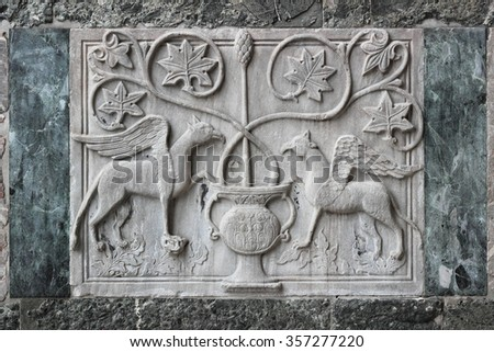 Bas-relief on the external wall of the Saint Mark Basilica in Venice - stock photo