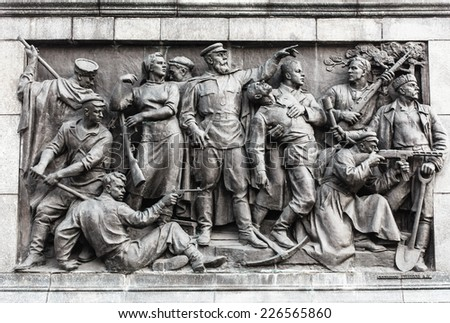 Bas-relief Scenes On The Wall Of The Stele Dedicated To The Memory Of The Great Patriotic War. Victory Square - Symbol Belarusian Capital, Minsk, Belarus - stock photo