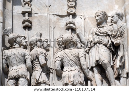 Bas-relief with the image of the emperor who made speech to the army. Fragment of an arch of Constantine. Rome. Italy. - stock photo