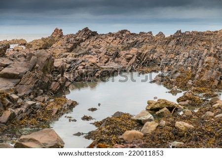 Basalt rock formations at the North Sea coast of Scotland