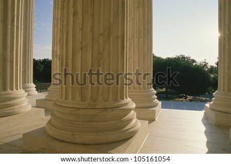 Base of columns at US Supreme Court building - stock photo