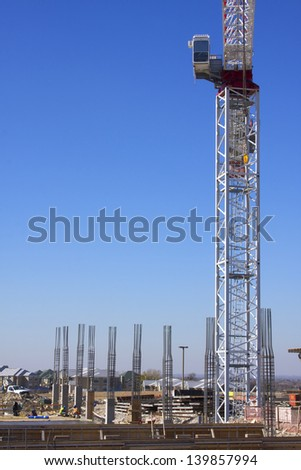 Base of construction crane and rebar columns - stock photo