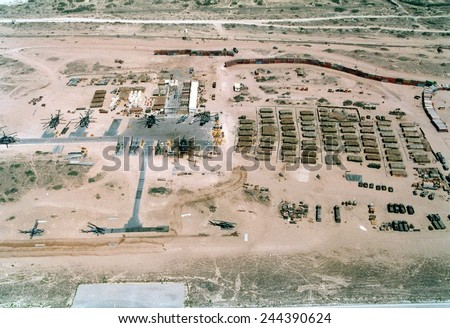 Base of the U.N. mostly U.S. Marine Forces in Somalia was built on an abandoned Soviet airfield in Mogadishu. Had a wall of shipping containers upper right to thwart random sniper fire. Feb. 25 1993. - stock photo