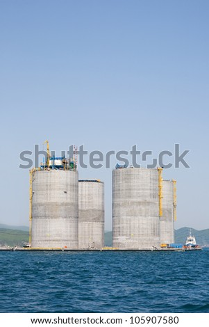 Base offshore oil drilling platform in a floating state. Sea Japan. Russian coast. - stock photo