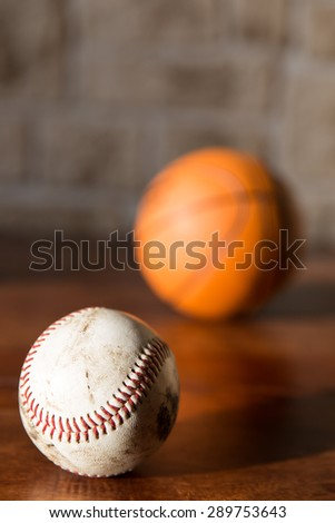 baseball and basketball on a wooden table