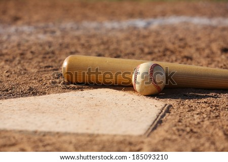 Baseball and Bat at Home Plate Close Up - stock photo