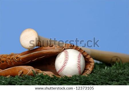 Baseball and Bat on grass - stock photo