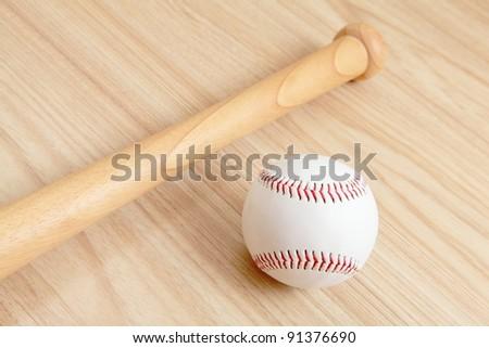 Baseball and bat with wood background - stock photo