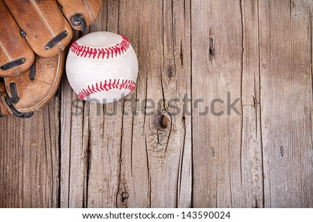 Baseball and mitt on rustic wooden background - stock photo
