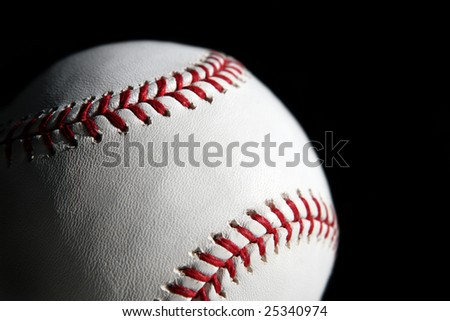 Baseball ball closeup isolated on black background