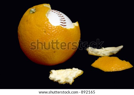 baseball ball inside orange on black background - stock photo