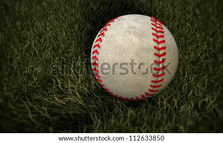 baseball ball on a small portion of green grass - stock photo