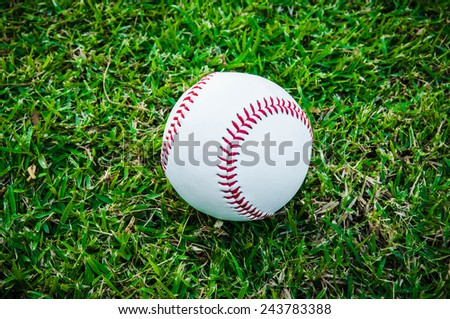 Baseball Ball on Grass Field (in Stadium or Local Field) Sport Concept and Idea / for background, wallpaper, texture. Standard Ball. - stock photo