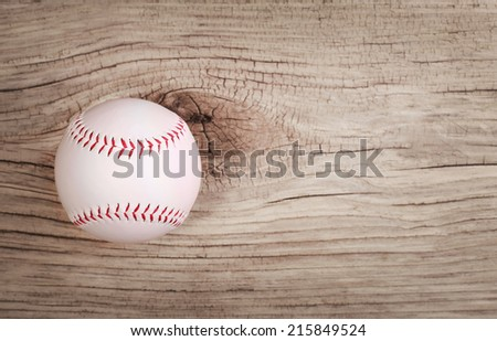 Baseball. Ball on wood background with copy space.  - stock photo