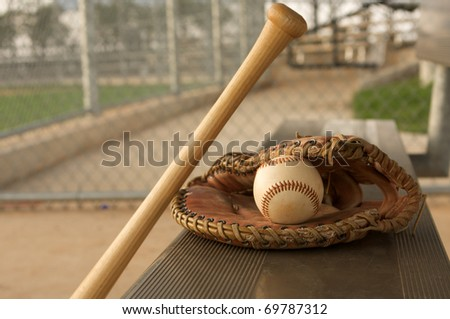 Baseball & Bat on the bench with a glove - stock photo
