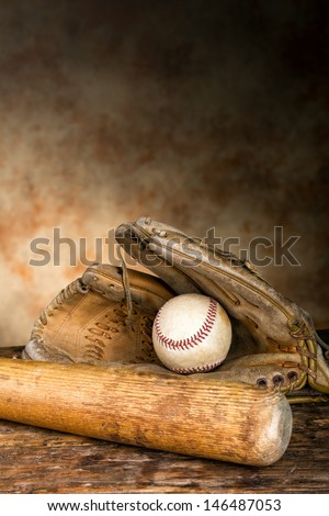Baseball bat with ball and old weathered glove