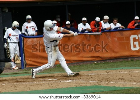 Baseball batter hitting the ball - stock photo