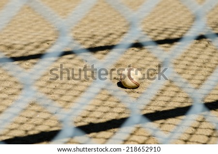 Baseball behind the fence - stock photo