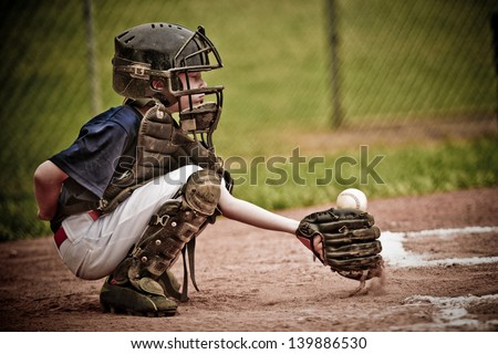 Baseball Catcher with Ball in Action - stock photo