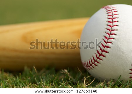 Baseball Close Up & Bat on the grass with room for copy - stock photo