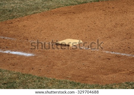 Baseball Field - Dusty 1st base during a baseball game. - stock photo