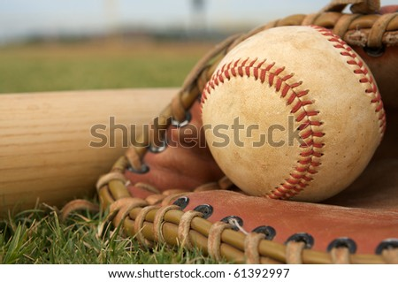 Baseball glove and ball on the field