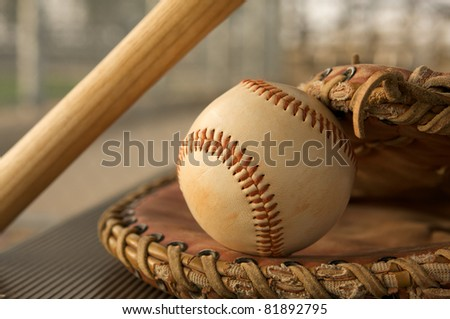 Baseball in a Glove on the bench - stock photo
