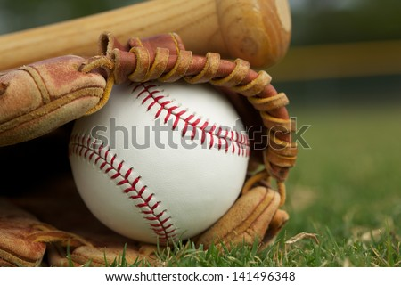 Baseball in a Glove on the Field - stock photo