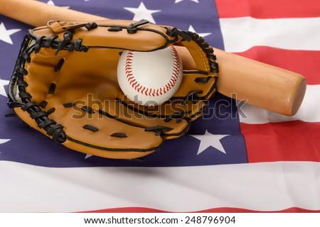 Baseball In An Leather Glove And Baseball Bat Over American Flag - stock photo