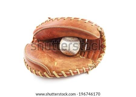 Baseball in catcher's glove - stock photo