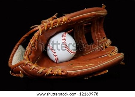 Baseball in glove isolated on black background.