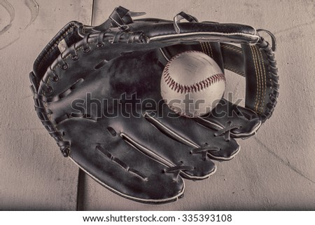 Baseball in old leather mitt, hdr horizontal image - stock photo