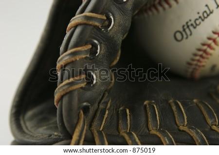 Baseball Mitt Close up showing leather stitching & Ball - stock photo