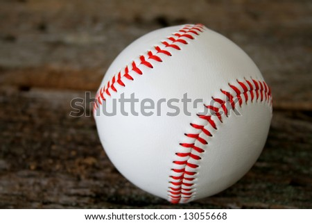 baseball on a wood textured background.