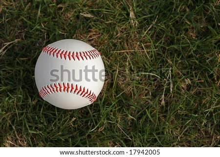 Baseball on grass with room for copy