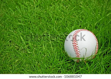 baseball on green grass pitch with copy space