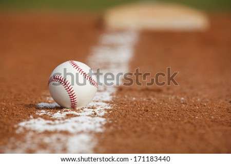 Baseball on the Infield Chalk Line Close up - stock photo