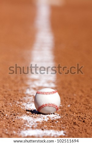 Baseball on the Infield Chalk Line with Base in the Distance