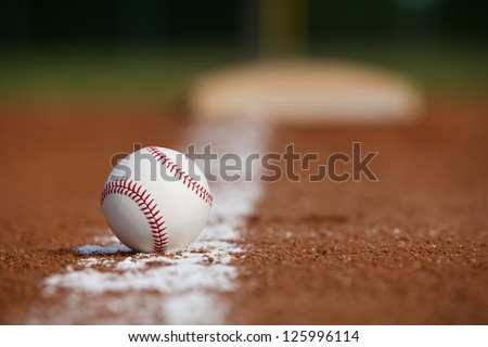 Baseball on the Infield Chalk Line with the Base in the distance - stock photo