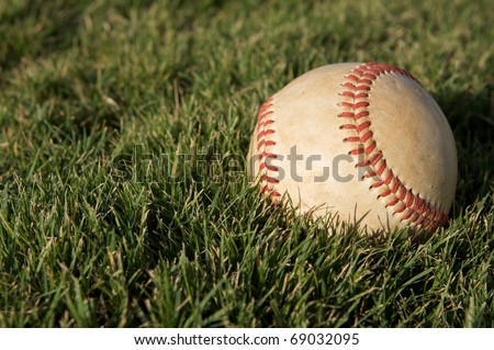 Baseball on the Outfield Grass of Field