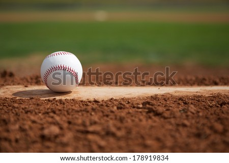 Baseball on the Pitchers Mound Close Up with room for copy - stock photo