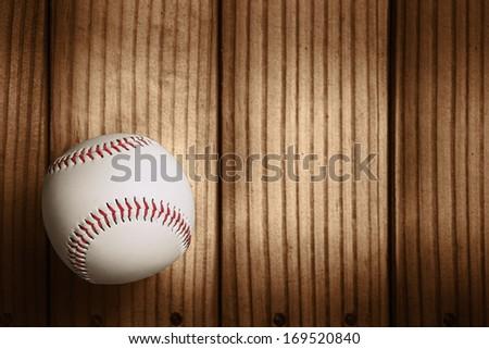 Baseball on wooden background - stock photo