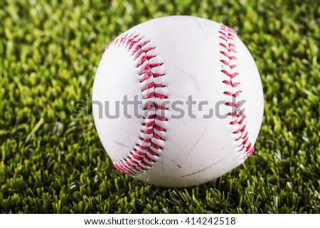 Baseball over green grass, close up, horizontal image