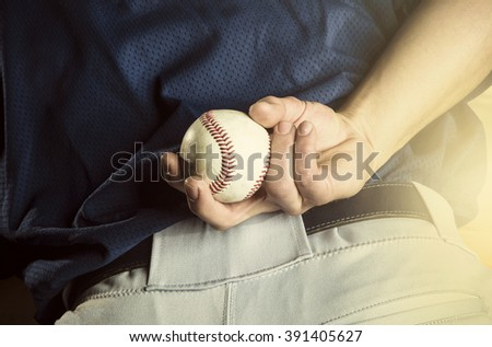 Baseball pitcher ready to pitch. Close up of hand focus on the fingers and the ball