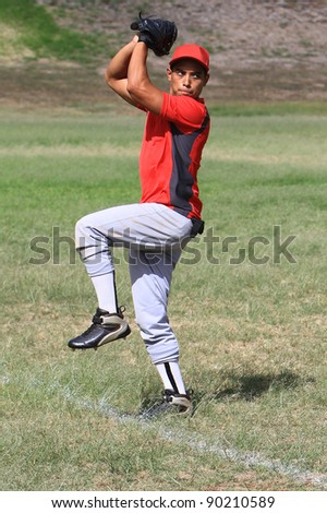 Baseball pitcher stands ready to throw - stock photo