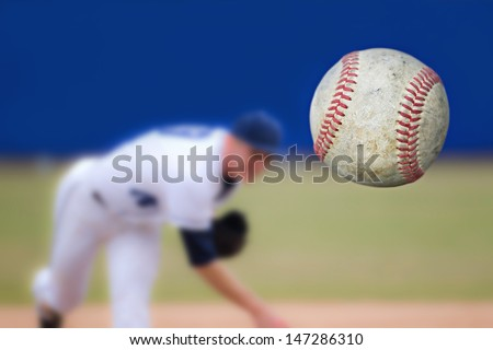 Baseball Pitcher Throwing ball, selective focus - stock photo